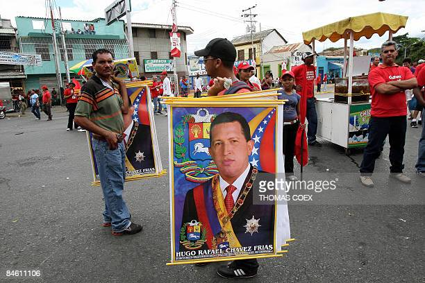 Street vendors sell posters of Venezuelan President Hugo Chavez during a visit by the head of state to the city of Cumana state of Sucre 275 kms east...