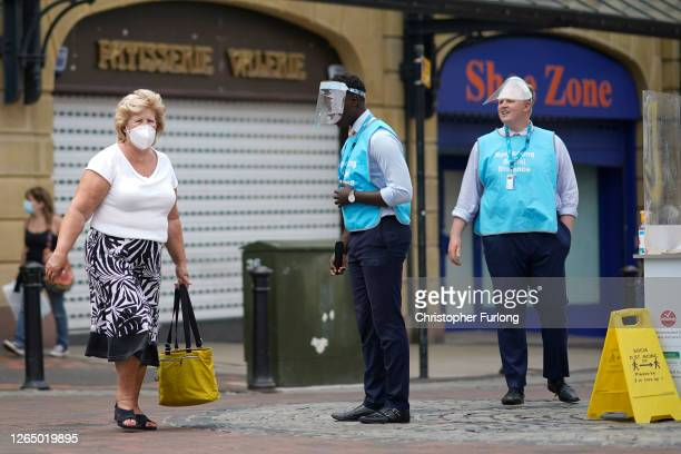 Street vendors selling domestic energy tariffs work in Preston town centre during the coronavirus pandemic on August 10, 2020 in Preston, England. As...