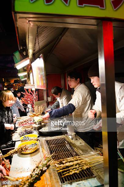 Street vendors selling exotic food on Wangfujings night market in Beijing - Chinas capital.