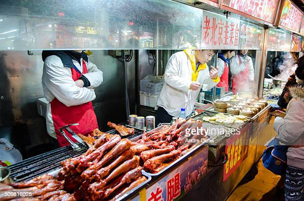 Street vendors selling exotic food to visitors of the Wangfujing Night Market in Beijing
