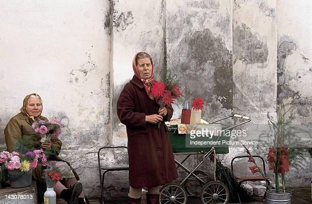 Street vendors selling flowers in Russia.