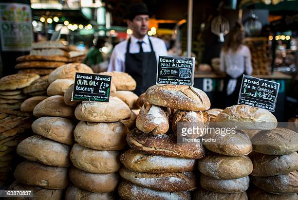 Street vendors selling fresh bakery products at London's Borough Market just off Thames.