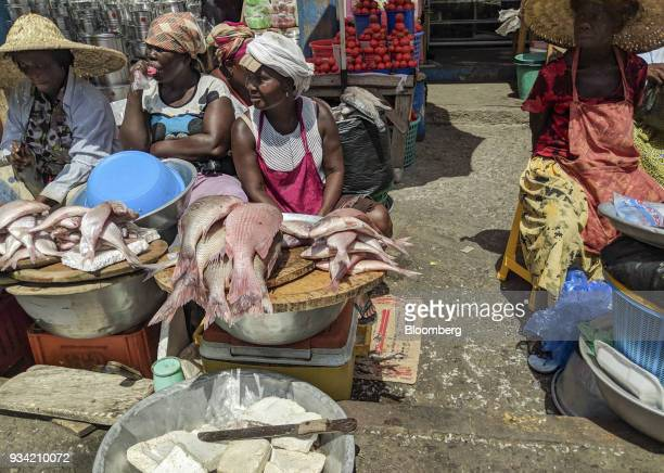 Street vendors selling fresh fish wait for customers in Accra Ghana on Thursday March 15 2018 Ghana wants to shake up the way it collects tax with...