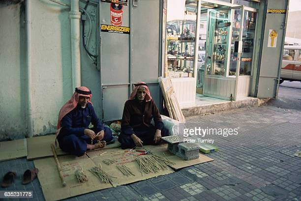 Street Vendors Sitting on a Sidewalk