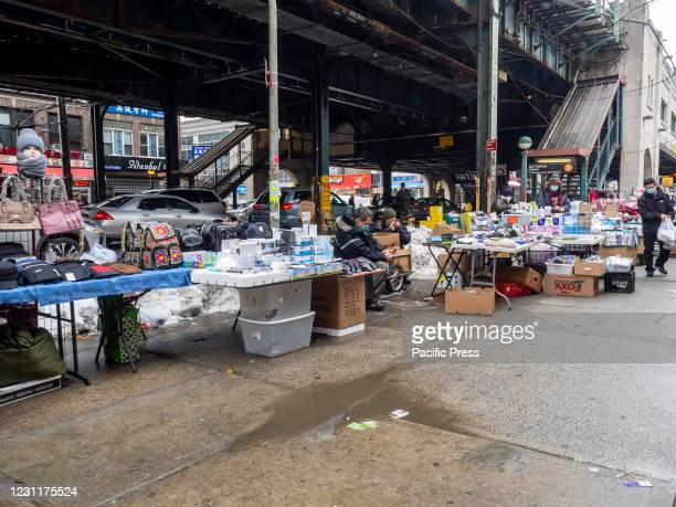 Street vendors, some of them illegal, overtaking streets of Bensonhurst trying to survive during pandemic time. Folding tables, closing racks, boxes...
