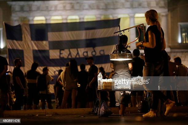 A street vendor's stall sits on Syntagma Square during a demonstration by antibailout protestors outside the Greek parliament in central Athens...