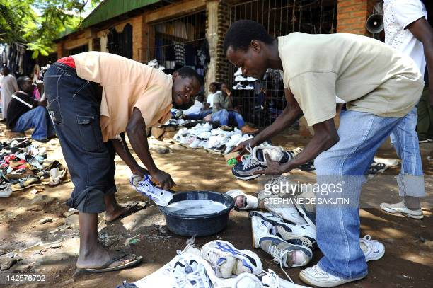 Street vendors wash shoes on April 8, 2012 in the streets of Lilongwe. Malawi's new President Joyce Banda was sworn in smoothly yesterday just hours...