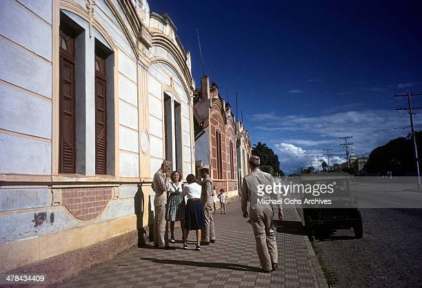 A street view as servicemen talk with locals in Natal Brazil