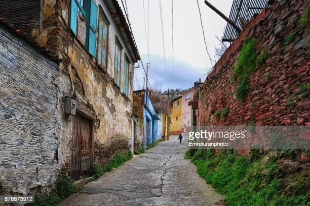 street view in tire on a rainy day,aegean turkey.. - emreturanphoto stock pictures, royalty-free photos & images