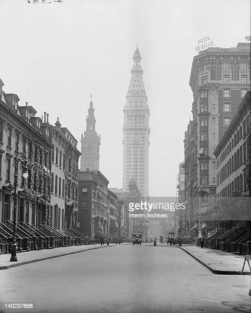 Street view looking south on Madison Avenue directly upon the Metropolitan Life Insurance Company Tower in center with the Stanford White designed...
