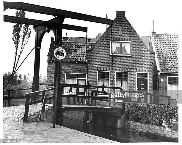 A street view of a little house and bridge in Volendam Holland