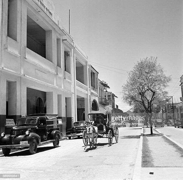 A street view of a man and his horse and buggy in PortauPrince Haiti