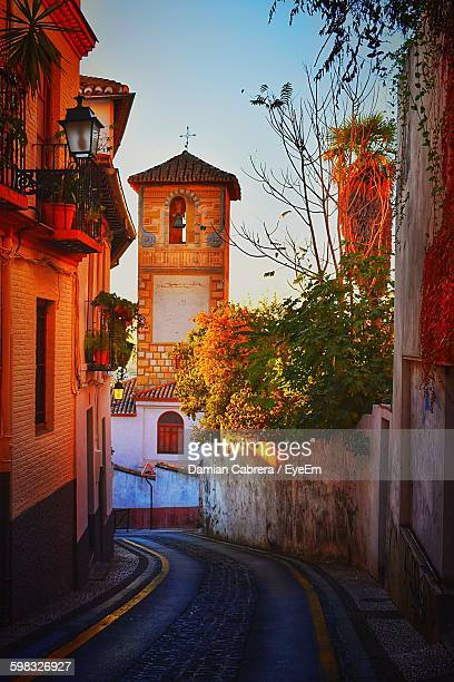 street view of bell tower against sky - granada stock photos and pictures