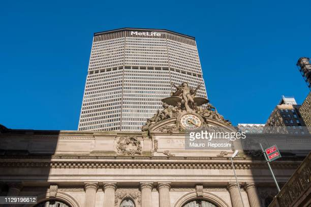street view of grand central station, pershing square bridge and metlife building during christmas season at manhattan, new york city, usa. - metlife building stock pictures, royalty-free photos & images