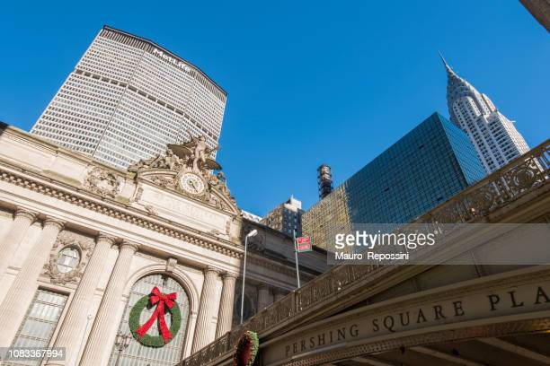 street view of grand central station, pershing square bridge, chrysler and metlife building at manhattan, new york city, usa. - metlife building stock pictures, royalty-free photos & images