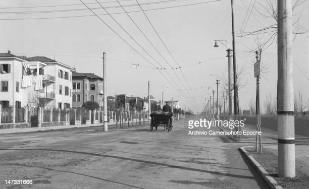 Street view of Lido in winter a gig passing by Venice 1951