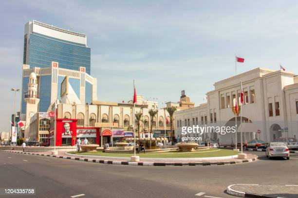 street view of manama, the capital city of bahrain - bahrain stock pictures, royalty-free photos & images
