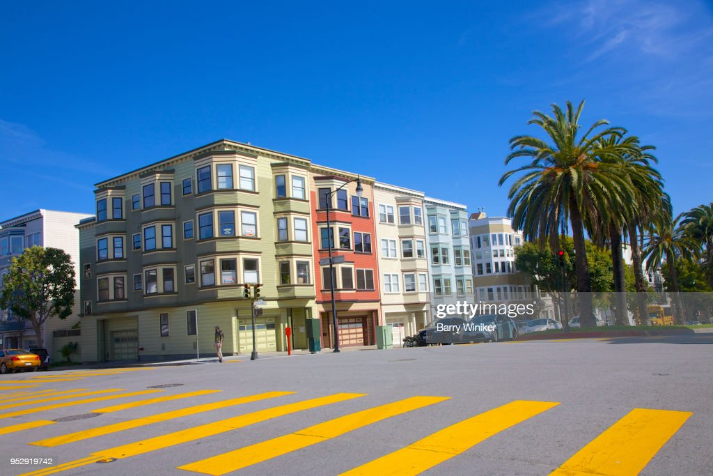 Street View Of Multi Colored Apartment Building In Mission District