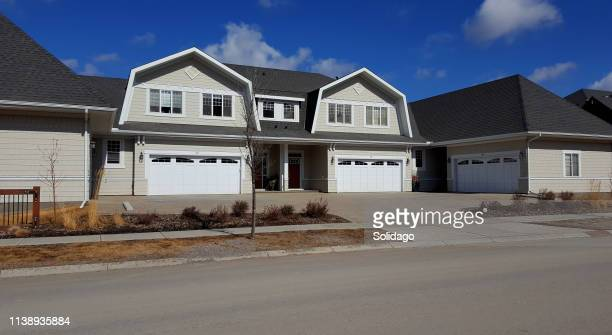 street view of new shingle style light gray 4 plex - herpes zoster foto e immagini stock