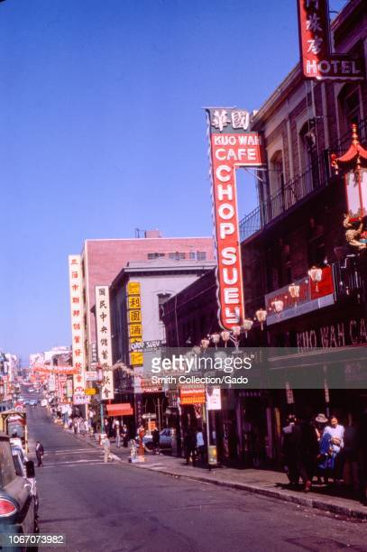 Street view of restaurants and shops on Jackson Street in the Chinatown neighborhood of San Francisco California including Kuo Wah Cafe Chop Suey...