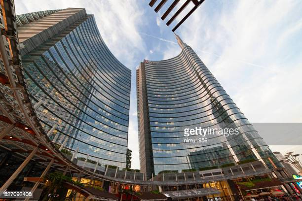 street view of the unicredit tower entrance in piazza gae aulenti, milan-italy - striato stock pictures, royalty-free photos & images
