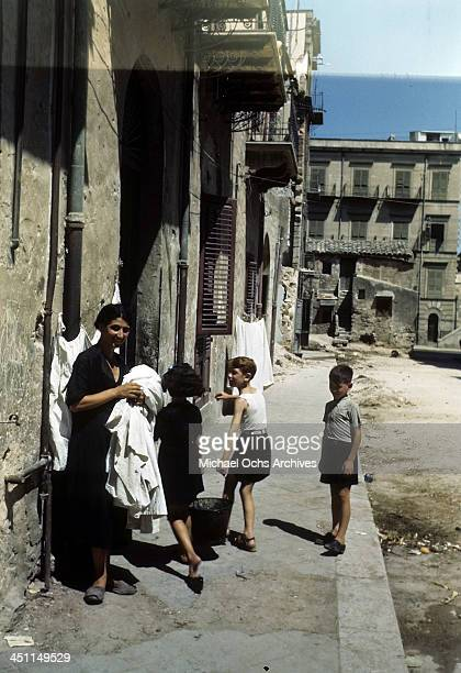 A street view Sicilian children after the invasion of Sicily called Operation Husky during the World War II in Palermo Sicily Italy