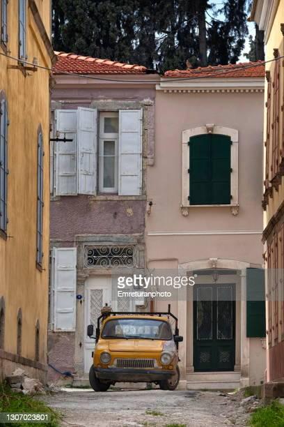 street view with parked pick-up truck in urla. - emreturanphoto stock-fotos und bilder
