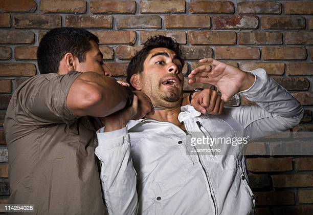 street violence - armed robbery stock photos and pictures
