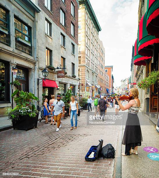 Street violonist plays for donations in old Montreal