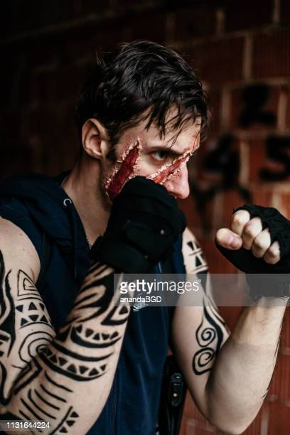 street warior - mixed martial arts stock pictures, royalty-free photos & images