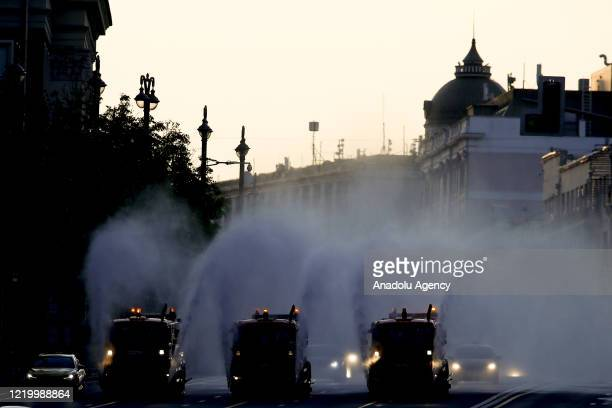 Street washers spray disinfectant before a rehearsal of a military parade in Red Square marking the 75th anniversary of the Victory in WWII in...