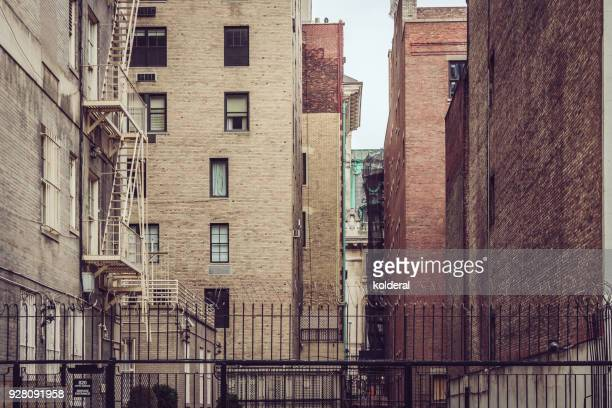 street with brownstone buildings in midtown manhattan - chelsea new york stock photos and pictures