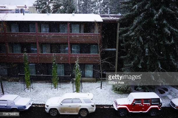 street with cars and apartment building in winter, canada - image stock pictures, royalty-free photos & images