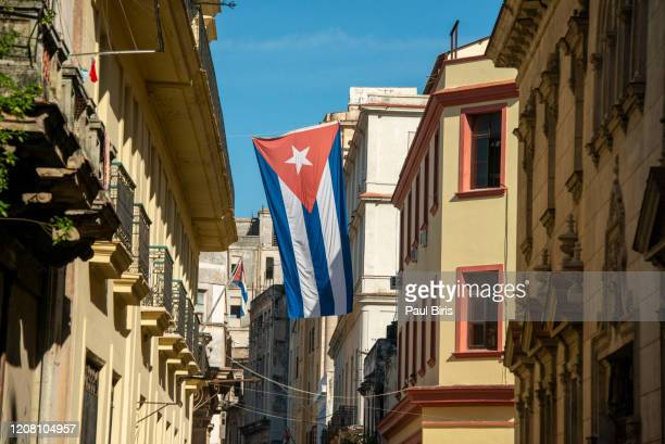 street with cuban flag in havana, cuba - cuba stock pictures, royalty-free photos & images