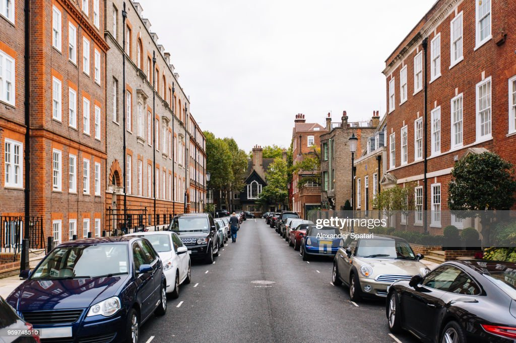 Street with parked cars in Kensington and Chelsea district, London, England, UK : Stock Photo