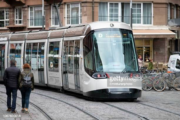 street with pedestrians and tram,strasbourg. - emreturanphoto stock pictures, royalty-free photos & images