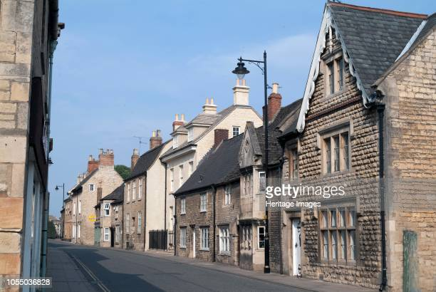 Street with row of traditional houses and architecture dating from medieval Georgian and Victorian times Stamford Lincolnshire east of England Artist...