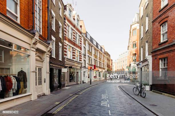 street with shops and cafes in marylbone, london, uk - street stockfoto's en -beelden