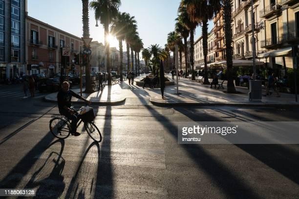 street with shops in bari, italy - bari foto e immagini stock