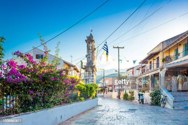 street with shops in city centre in kassiopi - corfu stock pictures, royalty-free photos & images