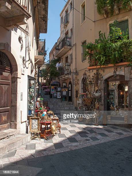 Street with souvenir shops on August 112013 in Taormina Italy