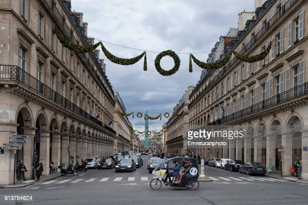 street with traffic and taxi-bike in paris. - emreturanphoto stock pictures, royalty-free photos & images