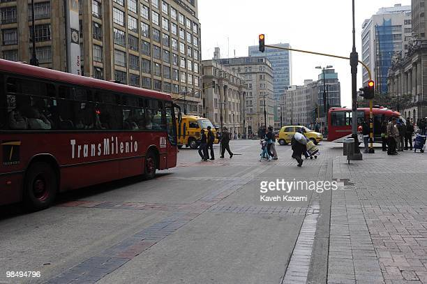 A street with Transmilenio bus running in both direction TransMilenio is a bus rapid transit system that serves Bogota Colombia The system runs...