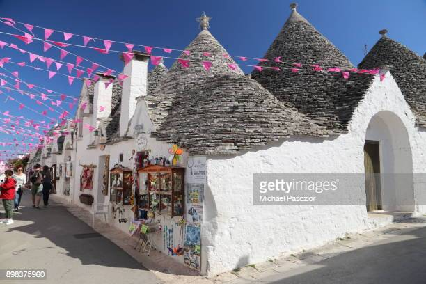 street with trulli houses - alberobello stock pictures, royalty-free photos & images