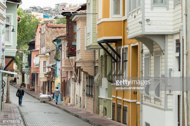 street with wooden houses in istanbul, turkey - historical istanbul stock pictures, royalty-free photos & images