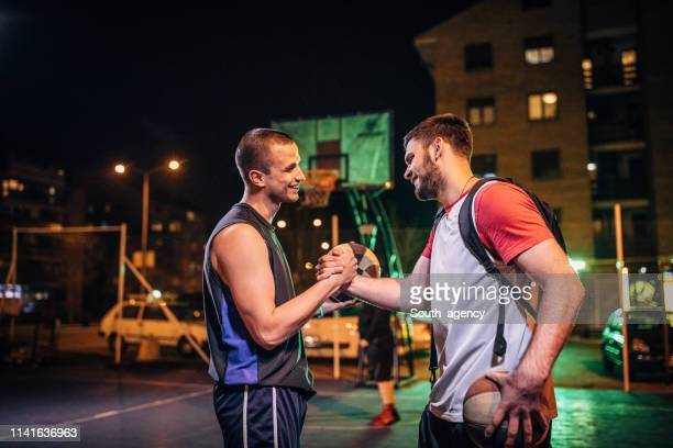 streetball friends handshake after game - sport venue stock pictures, royalty-free photos & images