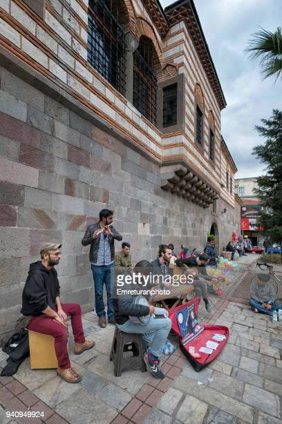 streetband playing outside kizlaragasi han,kemeralti. - emreturanphoto stock pictures, royalty-free photos & images