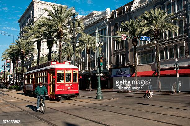 Streetcar and cyclist on Canal Street, New Orleans, Louisiana.