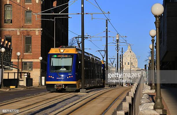 streetcar with the minnesota state capital in background, st. paul, minnesota, usa - capital cities stock photos and pictures