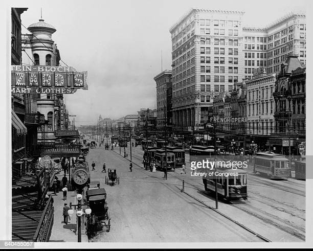 Streetcars run up and down Canal Street in New Orleans